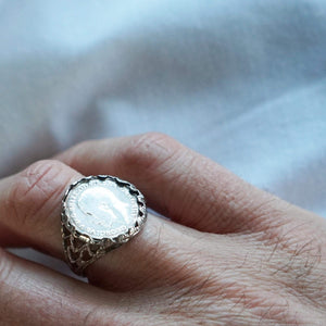 Vintage sterling silver coin ring on male models hand