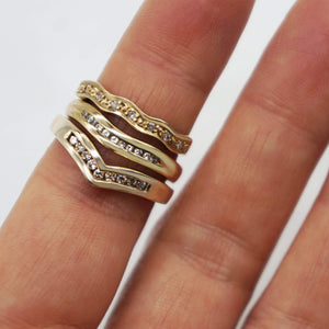 Close up of three Vintage 9K Diamond Wavy/ Curved Rings on Model's finger