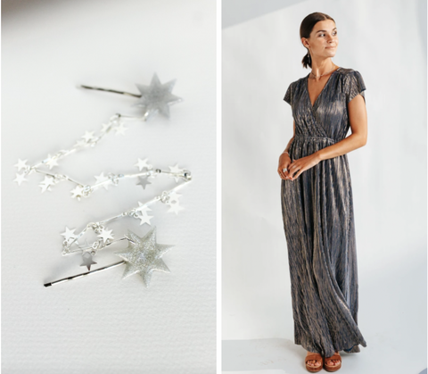 star pins with a star chain connecting and a silver maxi dress