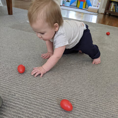 Baby Crawling to Red Shaker Eggs Developmental Play