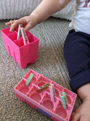 Baby Development Pulling Clothespins out of Duplo