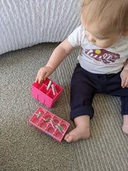 Baby Development Pulling Clothespins out of Legos