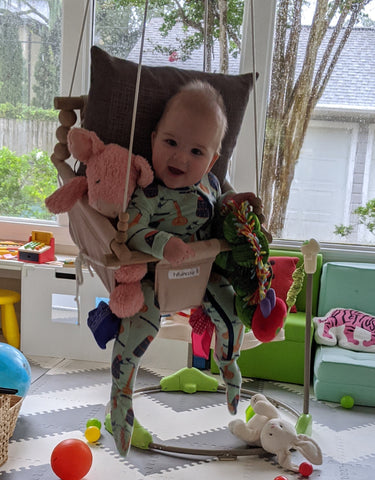 Baby in Swing with Stuffed Animals