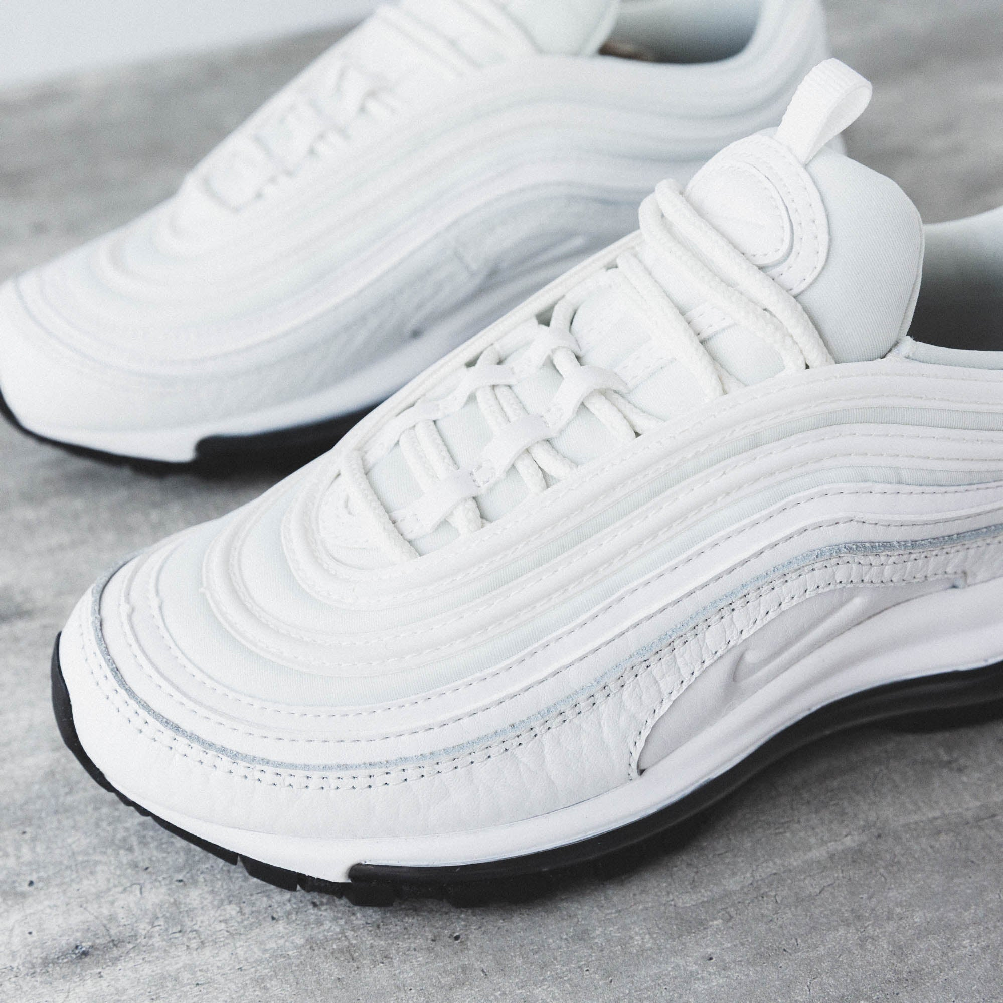 0fa7a7eeeef1d The shoe features an all-white upper made of leather and mesh, with 3M  reflective piping. Visit us in the Cove and cop a pair before they're gone!