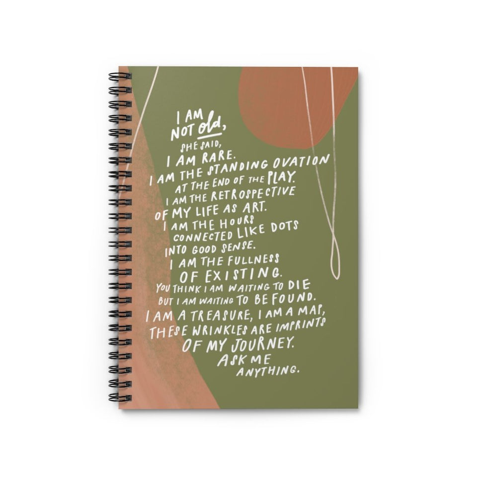 "Popular poem, ""I Am Not Old,"" by Samantha Reynolds printed on cover of beautiful olive green spiral notebook."