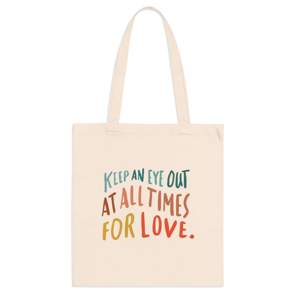 Trendy natural cloth errand bag printed on the front with hand-lettered colorful quote about love.