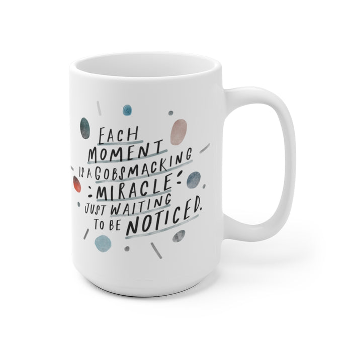 15 oz white coffee mug decorated with quote about mindfulness, designed with whimsical, abstract shapes.