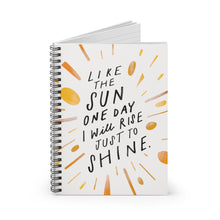 Load image into Gallery viewer, Spiral notebook, standing up on table, showing the cover with a big, creative, cool quote about living your best life.