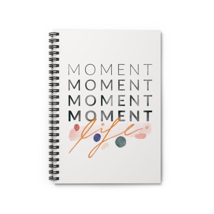 Inspiring statement about cherishing the little moments, with cute abstract shapes, printed on the cover of a spiral notebook.