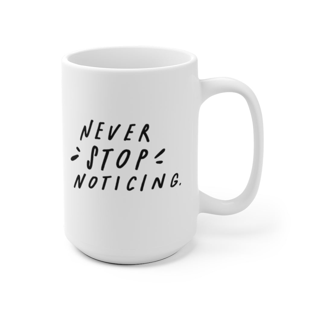 Minimalist 15 oz white coffee mug decorated with stark black hand-lettered quote about mindfulness.