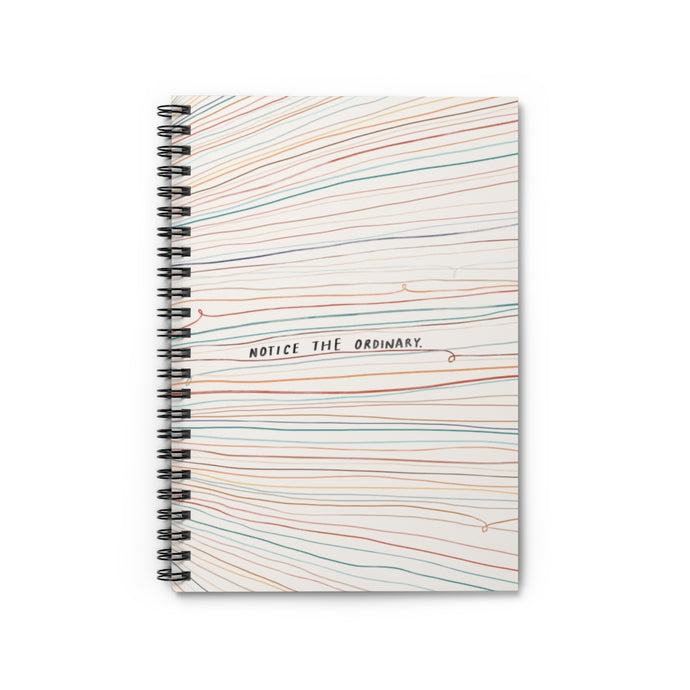"6"" x 8"" spiral notebook with hand-drawn colorful lines and a quote that reads ""Notice the ordinary"" on the cover."