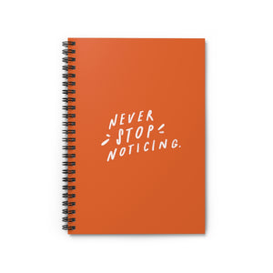 "Bright orange 6"" x 8"" spiral notebook with hand-lettered quote about mindfulness on the cover."