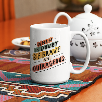 Inspiring word art about living your best life printed in bright, bold colors on the side of this 15 oz white ceramic coffee mug.