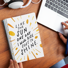 Load image into Gallery viewer, Woman hands holding a spiral journal with creatively hand-lettered quote about living your best life, on desk with laptop.