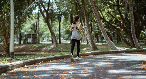 woman running; woman jogging; woman doing exercise in the park.