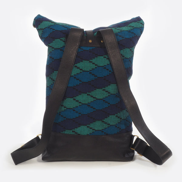 Back view of the Battiayo ,Deep Blue Sea' backpack with handwoven dhaka fabric and leather. The shoulder straps are versatile and can be changed in length.
