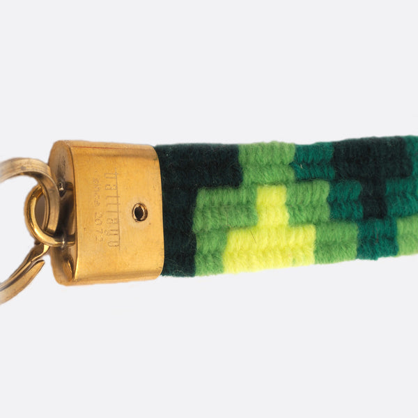 handwoven key chain with handmade brass buckle; key chain has 4 different shades of green