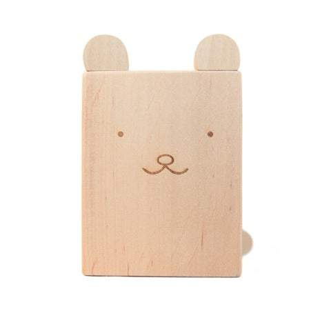 A cute bear pencil holder hand crafted and hand engraved in Europe. Made from solid alder wood, it's the perfect wooden accessory. Painted eyes, nose and mouth on side of pencil holder to give it a cute bear face.