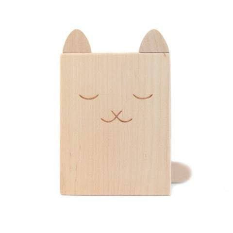 A cute cat pencil holder hand crafted and hand engraved in Europe. Made from solid alder wood, it's the perfect wooden accessory for encouraging kids to write and colour..