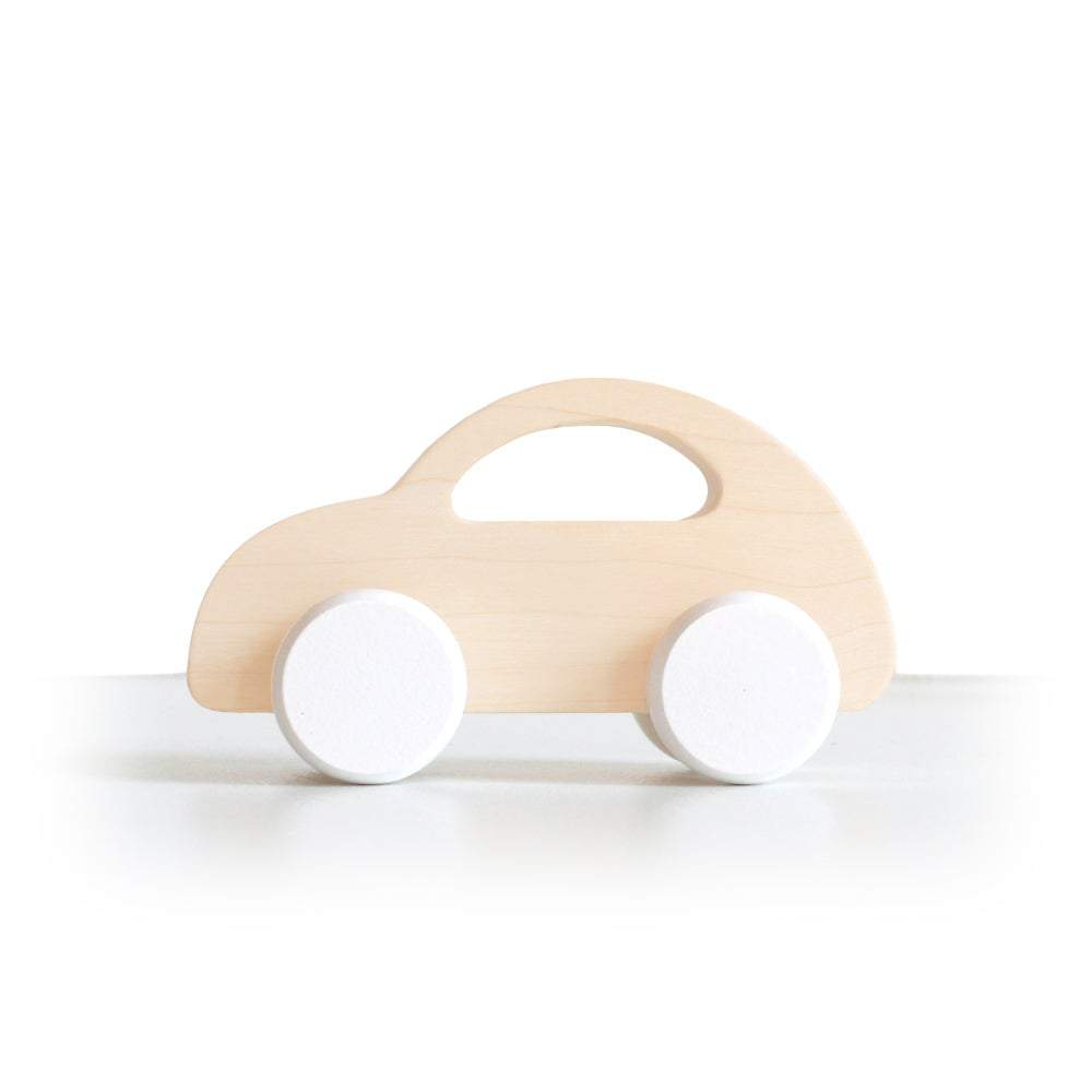 This beetle push car with white wheels has been handcrafted and hand-painted in Europe. Made from natural maple wood, it's perfect for encouraging imaginative play with little ones.