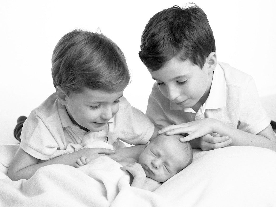 Child Portrait of a baby boy with his brothers