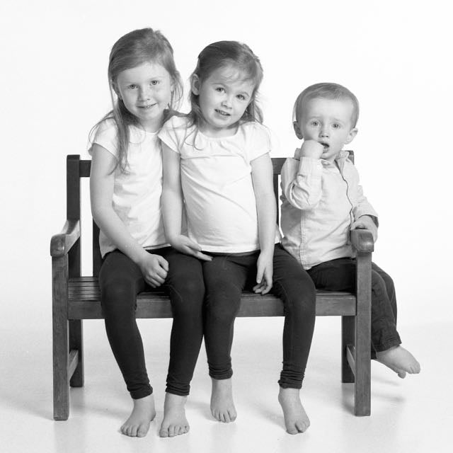 Portrait of three young children in black & white by PHOTOGENIC Dalkey