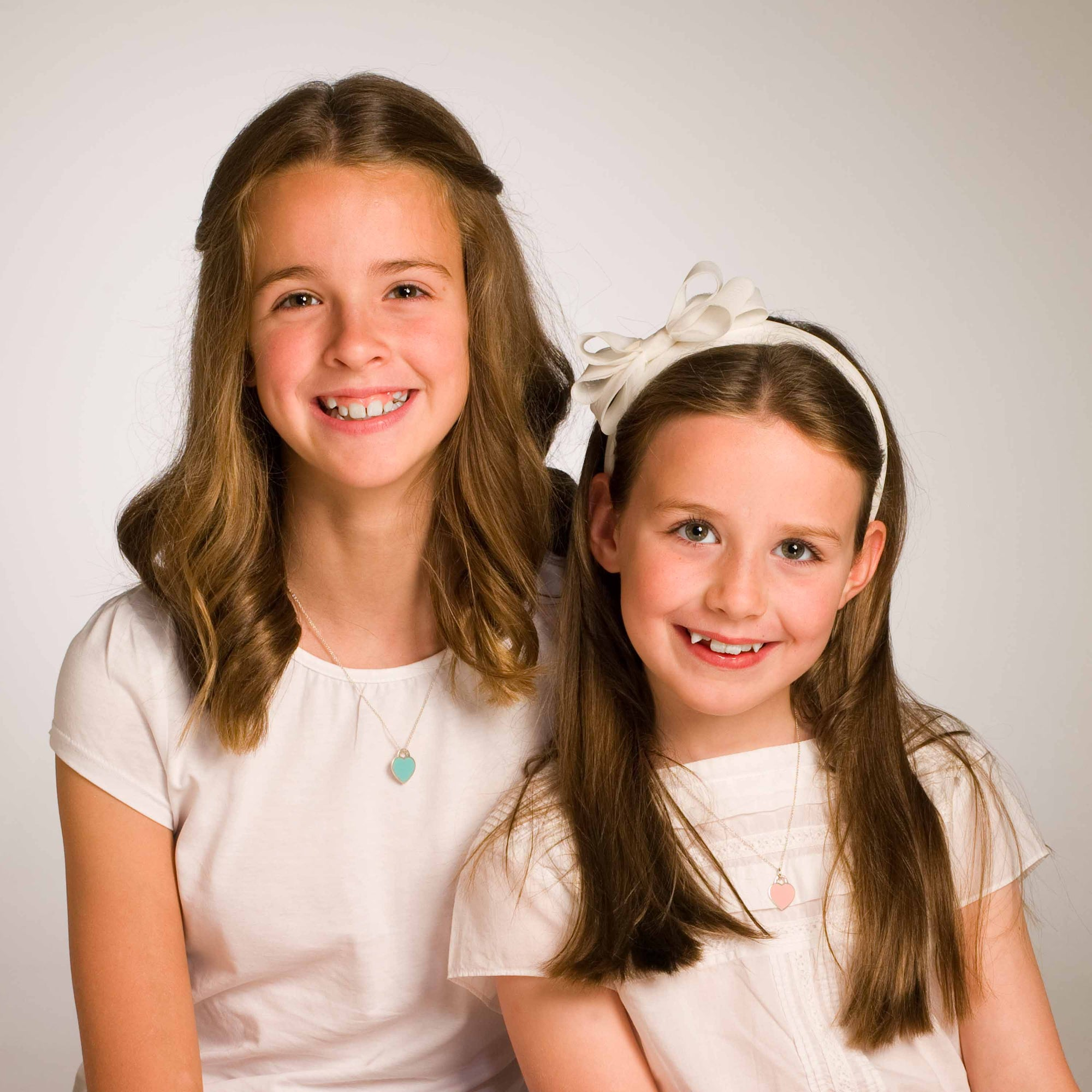 Communion and Confirmation portrait of two sisters in colour by PHOTOGENIC Dalkey