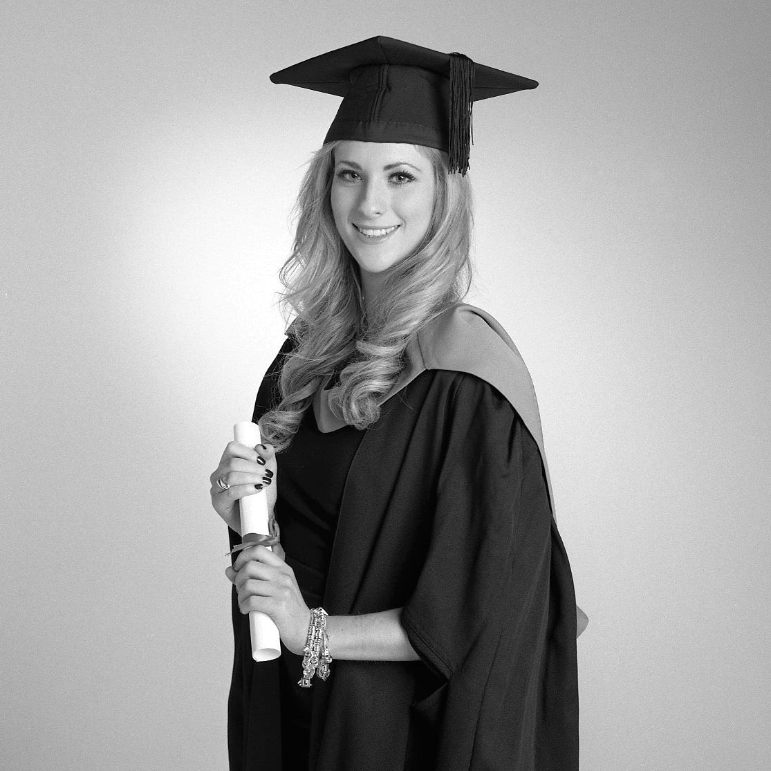 Graduation Portrait of a young woman in black and white by PHOTOGENIC Dalkey