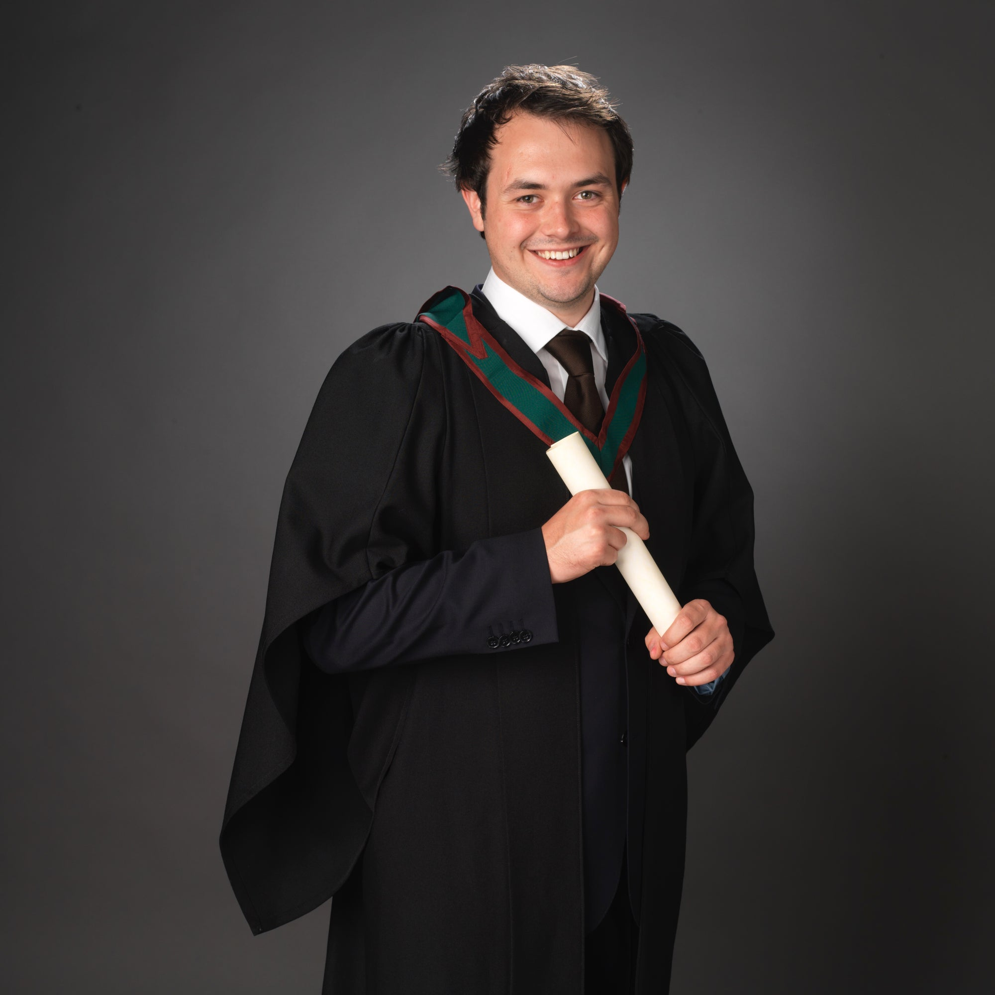 Graduation Portrait in of a young man by PHOTOGENIC Dalkey