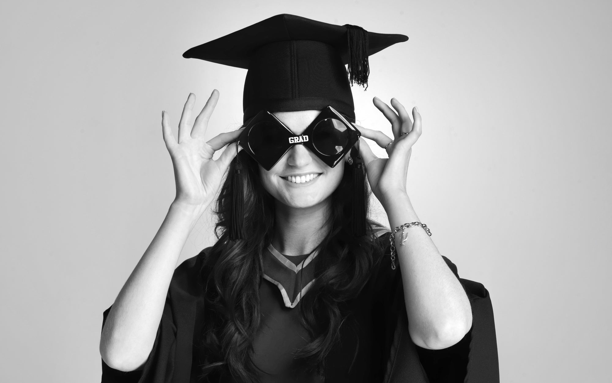 Fun themed Graduation Photograph of a young woman in black and white by PHOTOGENIC Dalkey