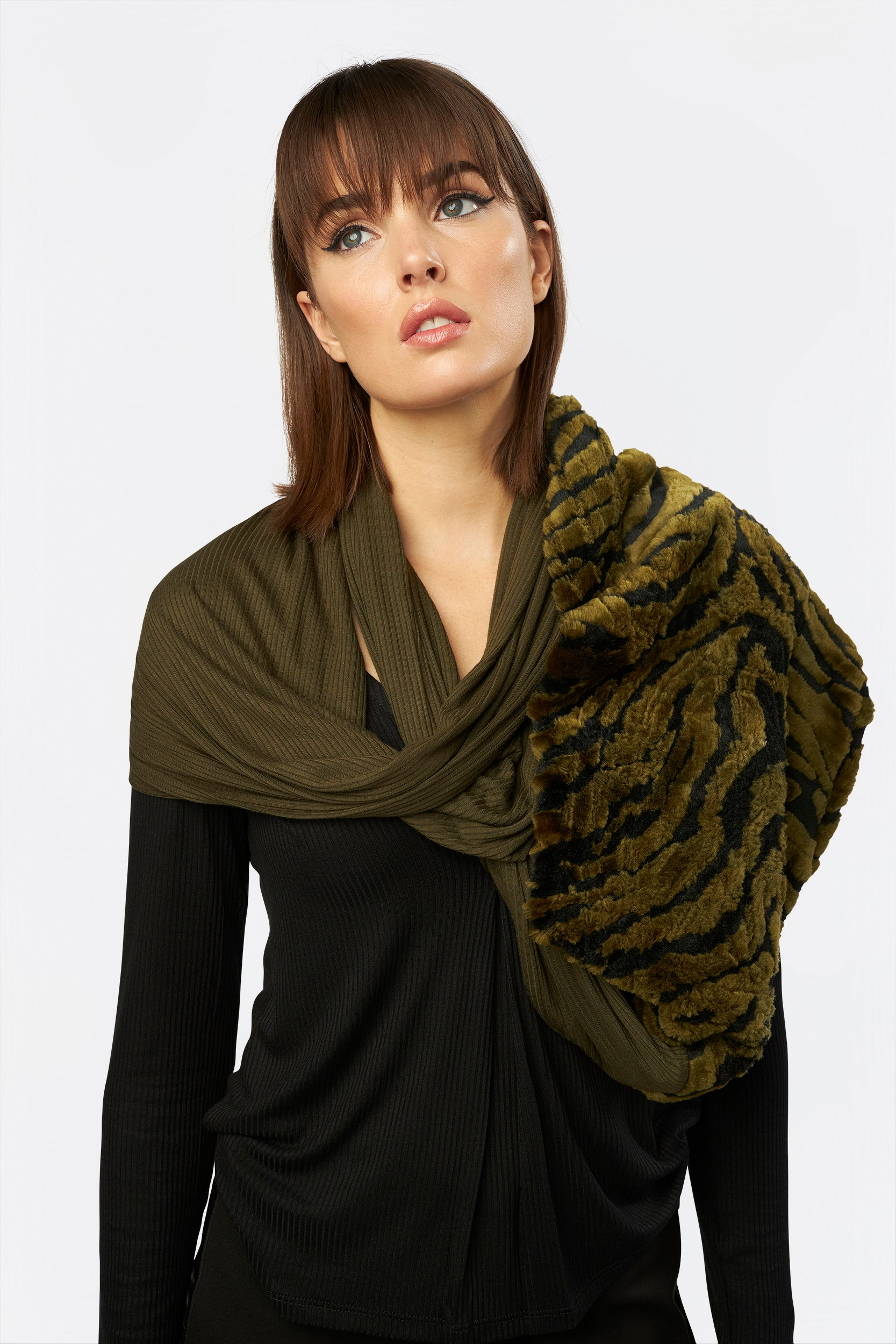 The Eternity Shrug by INLARKIN in olive zebra blends comfortable knit and luxurious faux fur