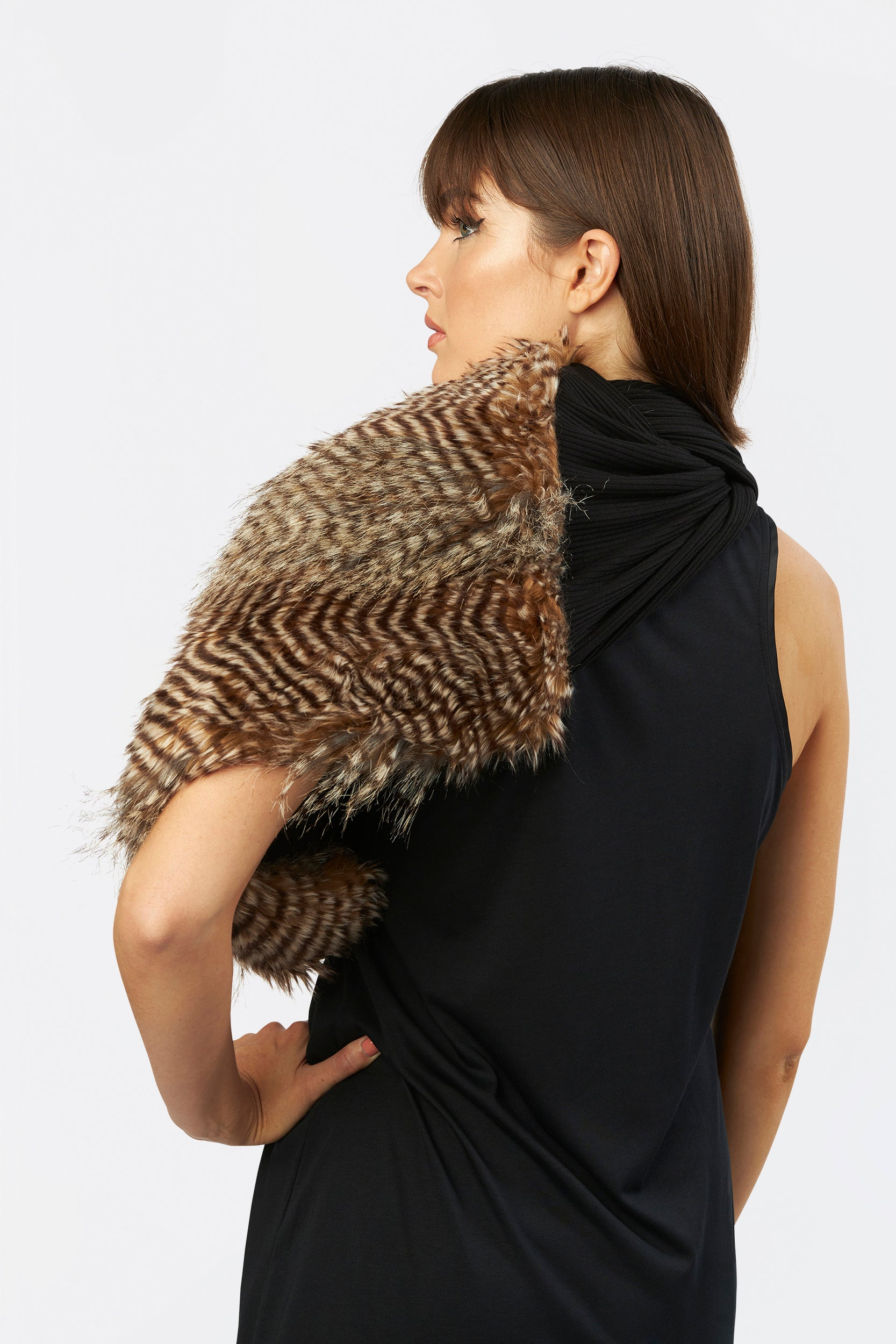 The Eternity Shrug by INLARKIN in animal print blends comfortable knit and luxurious faux fur