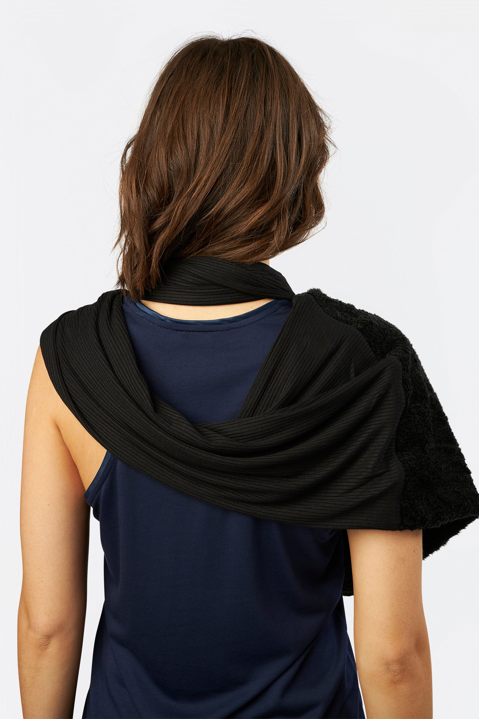 The Eternity Shrug by INLARKIN in black shag blends comfortable knit and luxurious faux fur