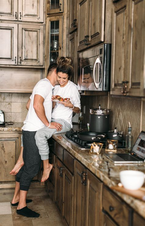 couples hot photography poses on the kitchen counter