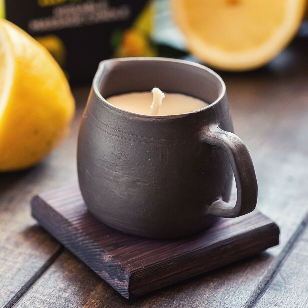 Edible massage oil candle in black pottery