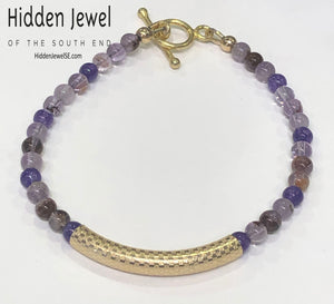 Amethyst and Super Seven gemstone bracelets, purple and gold bracelet