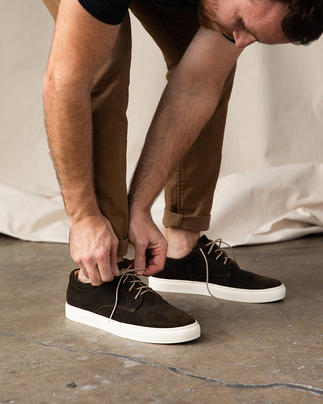 Nisolo Diego Low Top Sneaker Dark Olive Lifestyle Image