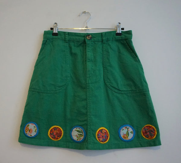 Green denim skirt with vintage patches