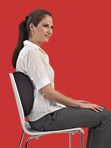 Lady using a lumbar support cushion for back pain relief