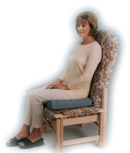 Load image into Gallery viewer, Lady using Putnams Pressure Relief Cushion with Coccyx cut-out