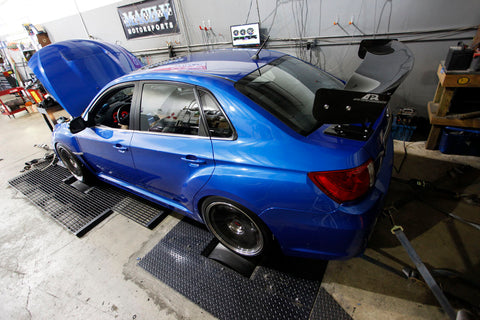 STI sedan on the dyno