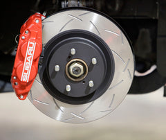Subaru four-pot front brake system