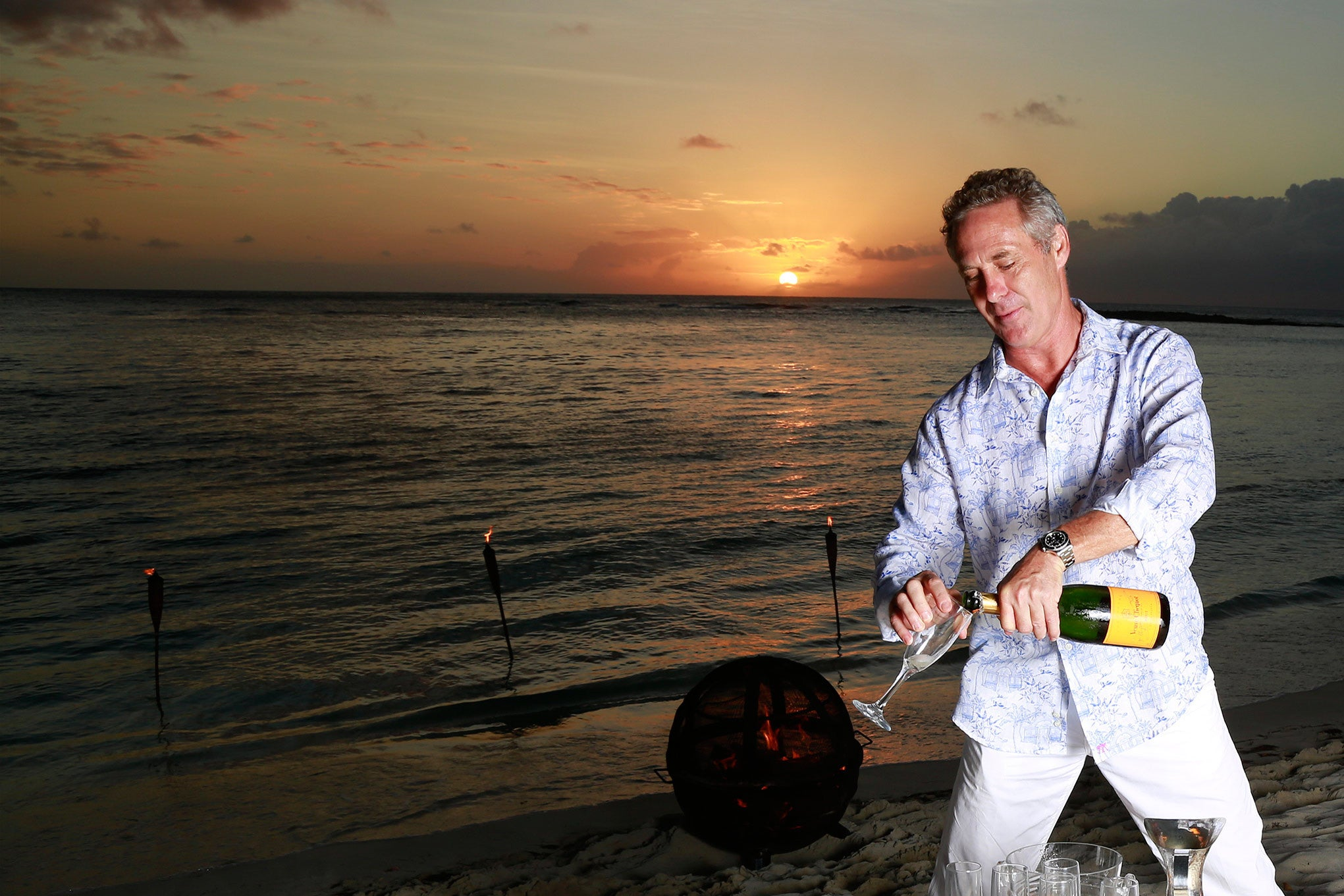 sunset champagne at lagoon Bay Mustique
