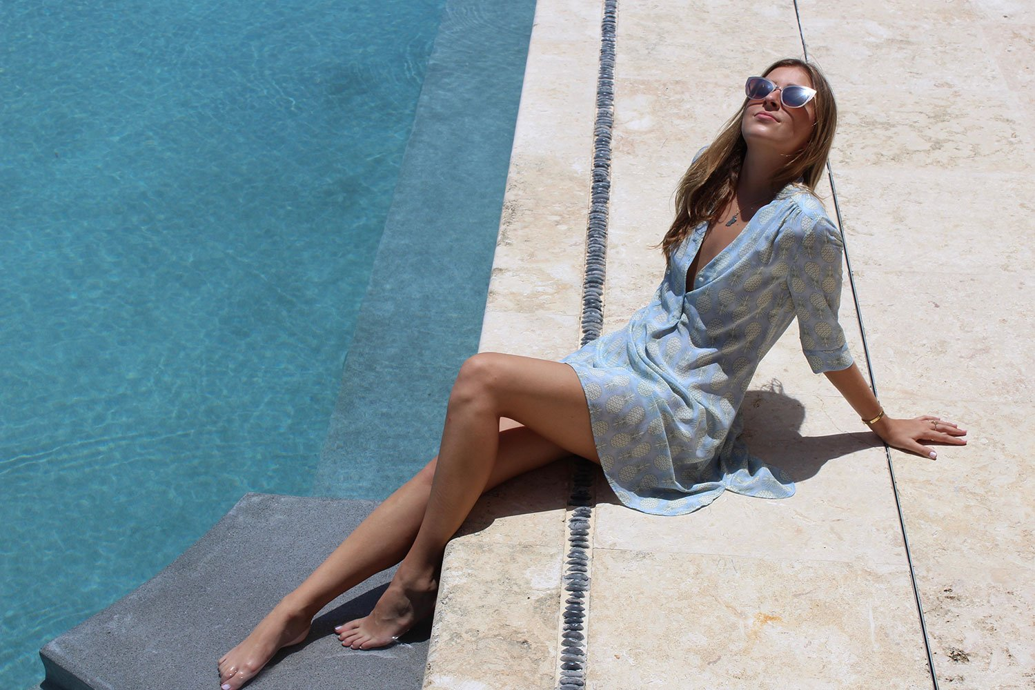 Designer vacation wear by Lotty B Mustique. Collections include comfortable easy to wear silks and linens.
