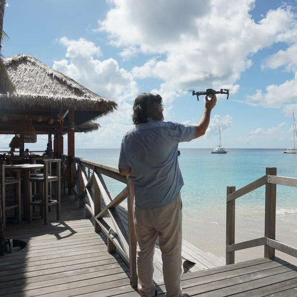 Alex Amengual launching drone camera at Basils Bar Mustique photographed by Lotty B