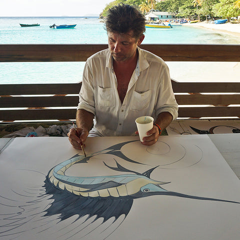 Alex Beard at work in Basil's Bar, Mustique