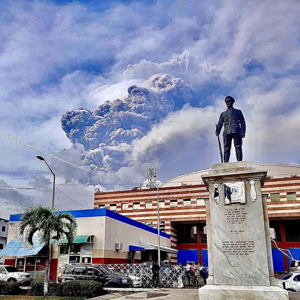 St Vincent Statue with the volcano eruption behind
