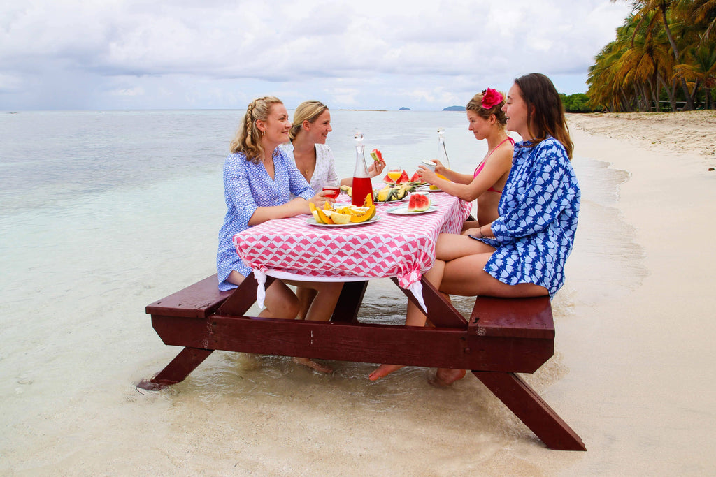 Sisters having a beach picnic, Mustique