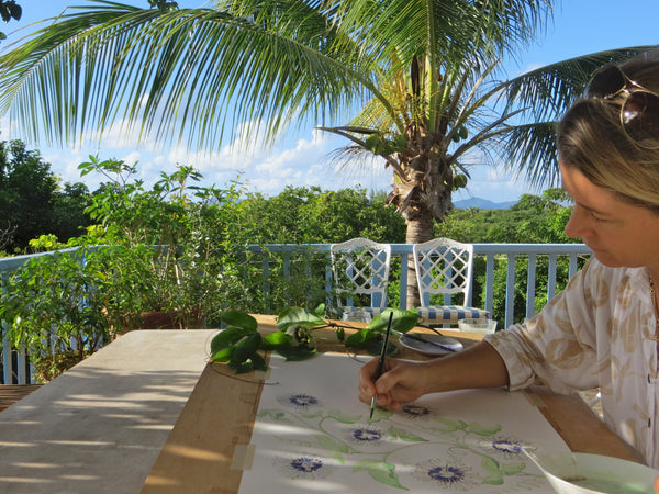 Lotty designing &painting at her home on Mustique