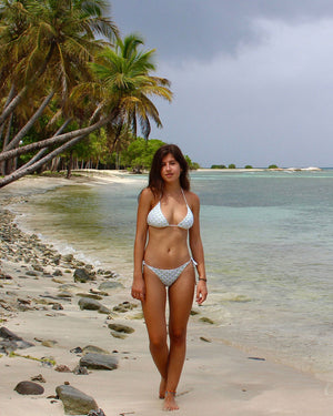 Womens Triangle Bikini : PINEAPPLE PRICKLES - OLIVE walking on the beach Mustique